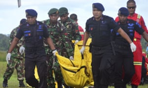 Indonesian soldiers and police carry a body bag containing the body of a victim of separatist attack in Nduga district in West Papua