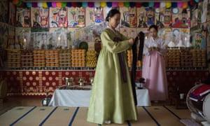 Rituals and resistance … shaman Min Hye-Gyeong, centre, in Yangju, Korea