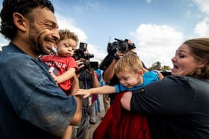 Chris Davis greets his girlfriend Donnie Sue Crow with their children Faydon (left) and Chris (right) after Donnie Sue was released from prison during what is believed to be the single largest mass commutation in United States history at the Eddie Warrior Correctional Facility.