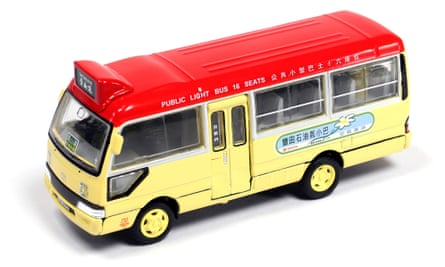 Miniature models of vintage (and modern) Hong Kong vehicles make for perfect gifts. The image shows a yellow toy bus with red roof.