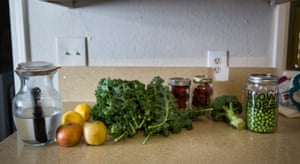 The fresh produce bought at the farmers' market sits on the countertop at her home, illustrating no packaging waste