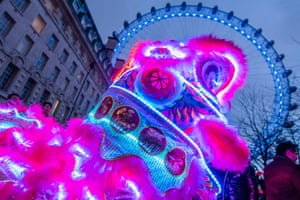 The eve of the Chinese new year of the pig is celebrated at the London Eye with Lion Dancers and a colour change to the wheel itself