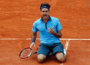 Roger Federer celebrates winning his only French Open title in 2009 to complete his career grand slam.