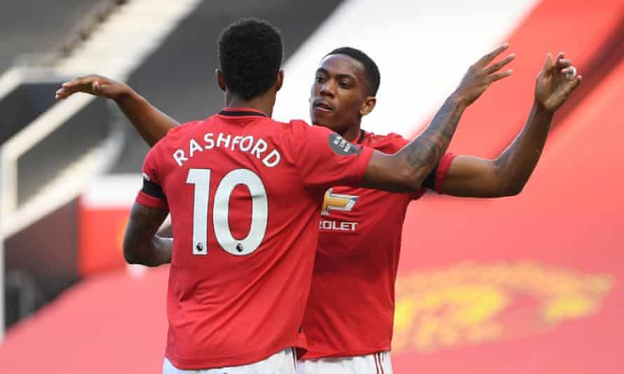Anthony Martial celebrates his opening goal with Marcus Rashford.