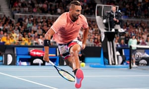 Nick Kyrgios plays a shot through his legs during his first round victory.