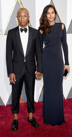 Pharrell. NEWS FLASH: It's the red carpet's first male bare ankle! Yes, Pharrell gone full on mankle. In fact, with his bleached blonde hair and black brogues, he's scoring very high fashion points.