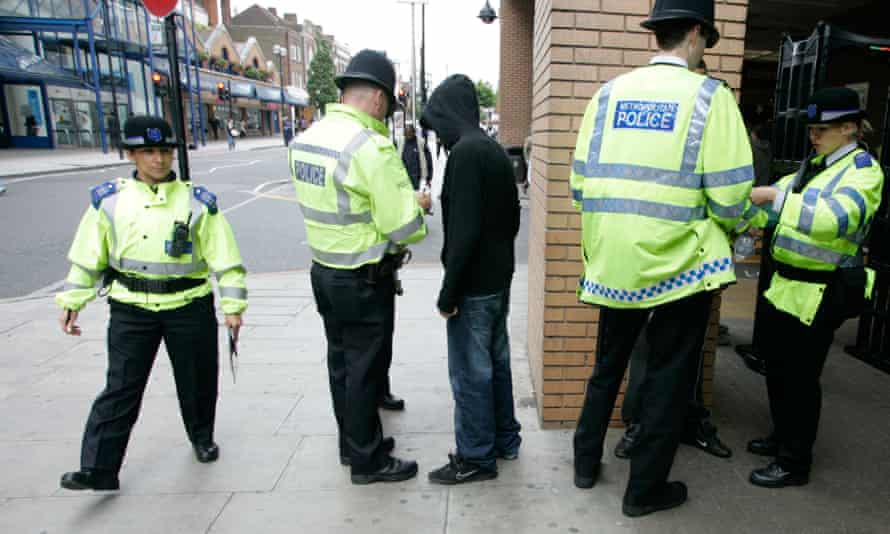 Police perform a stop and search in Harrow, London.