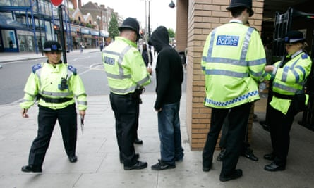 Police perform a stop and search in Harrow.