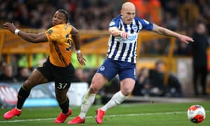Wolves' Adama Traoré and Brighton's Aaron Mooy contest possession at Molineux.