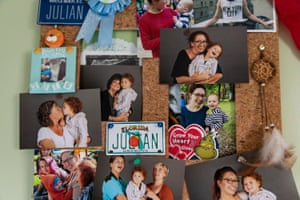 Photographs of Saige with her family in Julian's room.