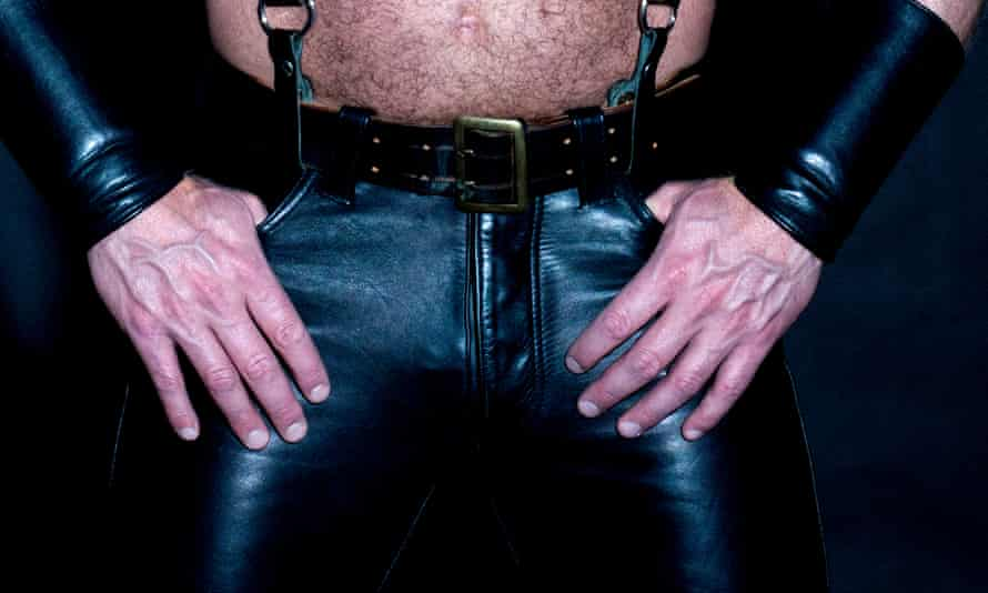 muscular male torso dressed in fetish leather<br>hairy muscular male torso dressed in fetish black leather
