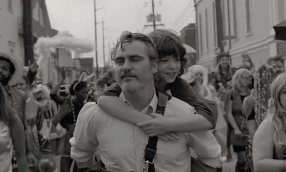 Joaquin Phoenix and Woody Norman.