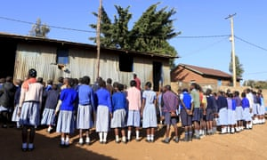 Students attend the morning parade at a school in Kenya's Kibera slums in the capital, Nairobi