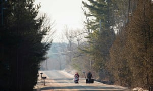 A family of four from Pakistan walk down Roxham Road in Champlain, New York, towards the US-Canada border on 28 February 2017.