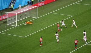 Iran's Alireza Beiranvand makes a smart save from the shot by Hakim Ziyech.