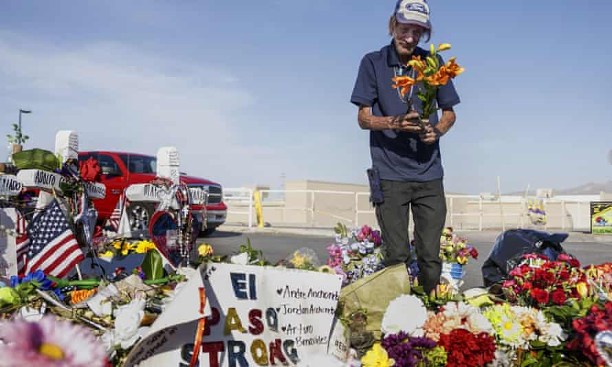 Antonio Basco, whose wife Margie Reckard was one of 22 killed at a local Walmart, lays flowers in her honor at a memorial on 16 August 2019 in El Paso, Texas.