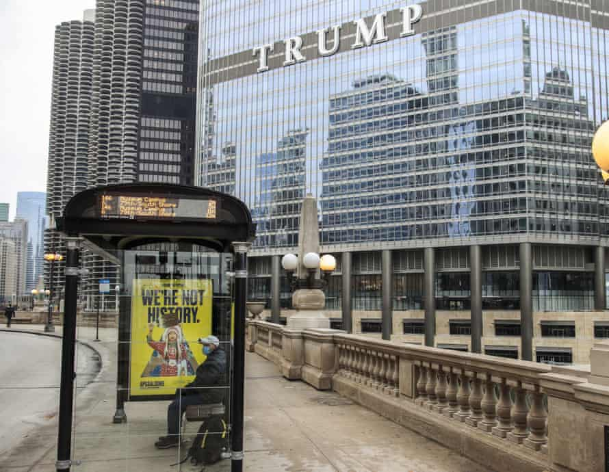 A man sits on an indoor bus near the Trump International Hotel & Tower in Chicago.  Illinois  in january