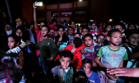 Children watch an event at the Abu Sultan high school in Ismailia, north of Cairo