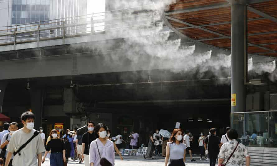 Water atomisers cool pedestrians outside Yurakucho station in Tokyo, Japan.