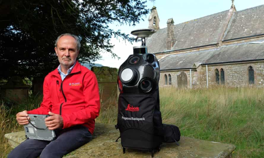 Tim Viney with his surveying equipment.