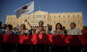 Supporters of the Greek ruling Syriza party shout slogans during an anti-austerity rally in front of the parliament in Athens, Greece, Wednesday, June 17, 2015.