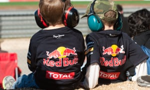 two young fans watching Formula One Red Bull jackets