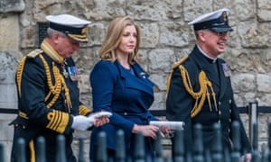 Penny Mordaunt leaving Westminster Abbey with senior naval officers