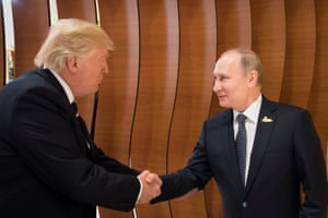The US and Russian presidents, Donald Trump and Vladimir Putin, shake hands during their first official meeting