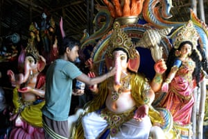 Hyderabad, India An artist puts the final touches to an eco-friendly figure of the Hindu deity Ganesh