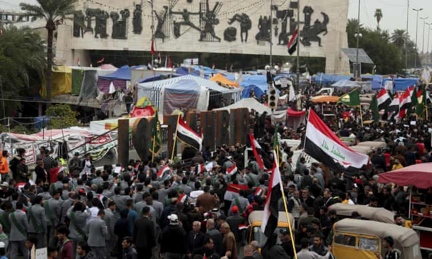People holding national flags and chant religious slogans march in Tahrir Square