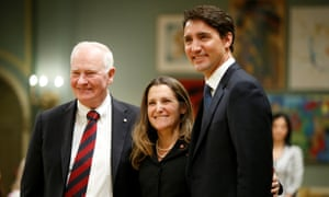 Chrystia Freeland poses with Canada's governor general, David Johnston, left, and the prime minister, Justin Trudeau, after being sworn-in as Canada's foreign affairs minister in Ottawa.