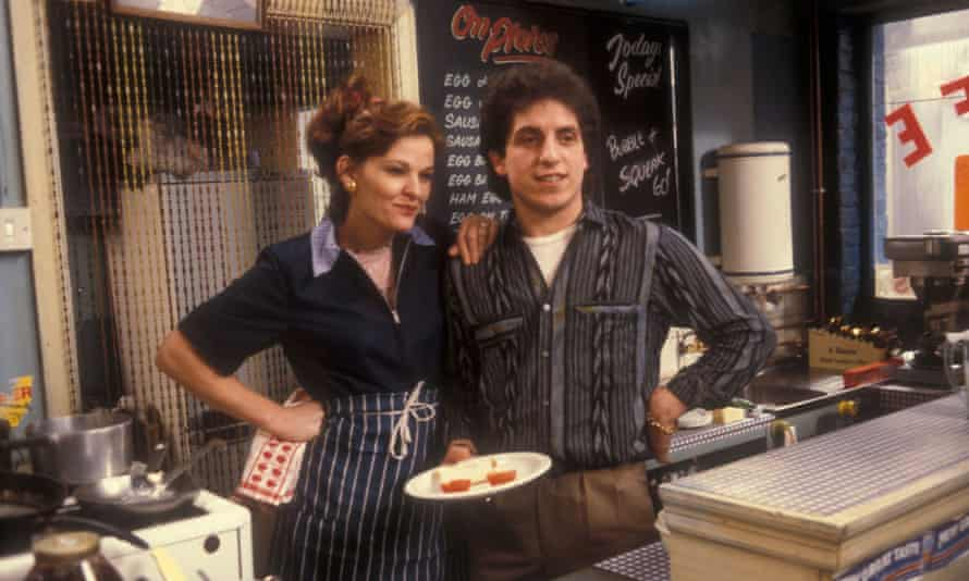 Sandy Ratcliff as Sue Osman with her husband, Ali, played by Nejdet Salih, on the set of EastEnders in the fictional Bridge Street cafe.