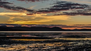 The setting sun creates an explosion of colour over and around the Struie Hill and Dornoch Bridge in NW Scotland.
