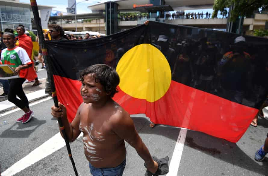 An Indigenous boy on a march through central Brisbane on Invasion Day, AKA Australia Day, in 2017.