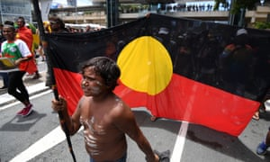 Demonstrators march through central Brisbane