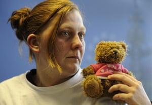Karen Matthews holds her daughter's favourite teddy bear as she makes an emotional appeal for her safe return