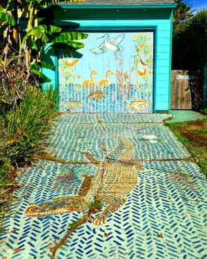 From a series of photographs by Ian Wood of garage doors painted with murals and street art in Berkeley, California.