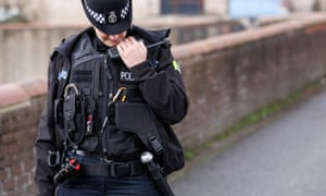 police officer on her radio on the beat