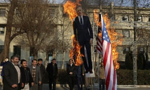 Protesters set fire to US and British flags and a life size cut-out of the the UK's ambassador Rob Macaire in Tehran on Tuesday.