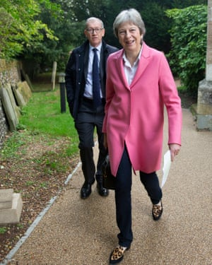 Philip May walks behind his wife in a churchyard