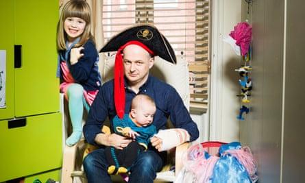 Johnny raids the dressing-up box with Robin and Nina.