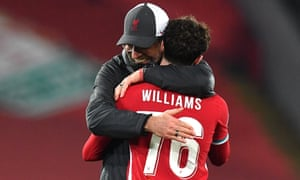 Liverpool FC vs Ajax Amsterdam<br>epa08856152 Liverpool manager Juergen Klopp (L) congratulates player Neco Williams after the UEFA Champions League group D soccer match between Liverpool FC and Ajax Amsterdam in Liverpool, Britain, 01 December 2020.  EPA/Paul Ellis / POOL