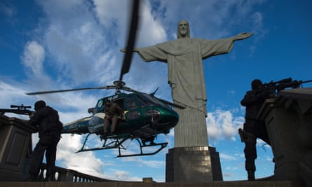 Brazilian police in front of Christ the Redeemer statue on Corcovado Hill in Rio de Janeiro.