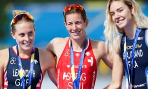 Nicola Spirig (centre) celebrates winning the gold medal in the triathlon ahead of Jessica Learmonth (left) and Cassandre Beaugrand.