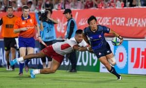 Kenki Fukuoka of Japan runs past Sitiveni Mafi of Tonga during the Pacific Nations Cup match this month.