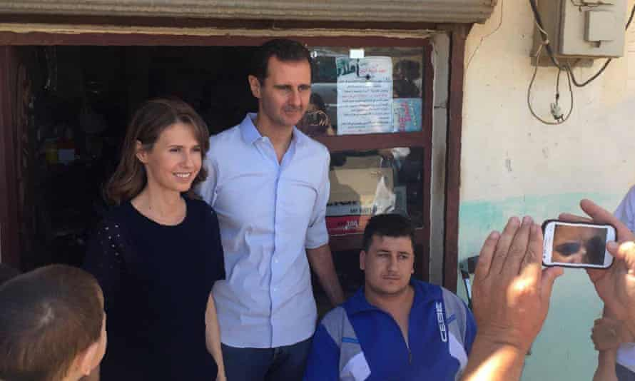 Syrian president Bashar al-Assad and his wife Asma visit an injured man from Tanunaah, Homs.