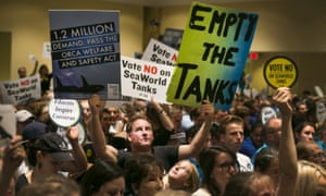 Opponents and supporters of SeaWorld fill the room during a California Coastal Commission meeting in Long Beach, California.