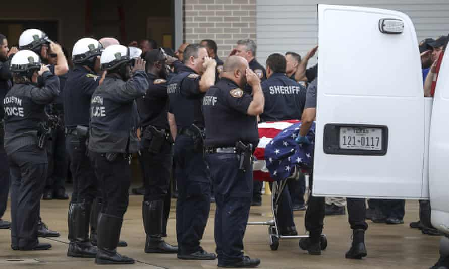 Officers escort the body of deputy Sandeep Dhaliwal, who was shot and killed after a traffic stop on Friday.