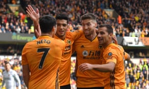 Matt Doherty takes the congratulations of his Wolves teammates after opening the scoring against Norwich.