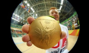 Ed Clancy of Britain poses with his team pursuit Olympic gold medal at Rio 2016.